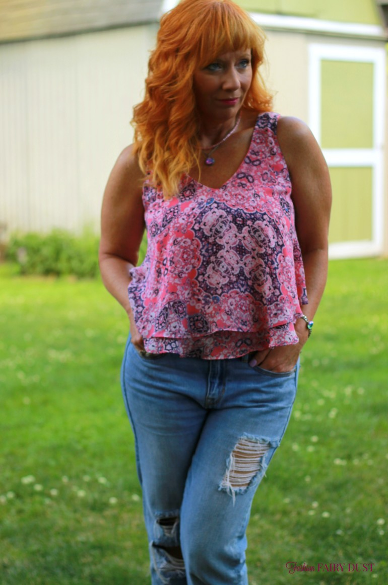 pink flounce tank top, distressed boyfriend jeans, fringe sandals