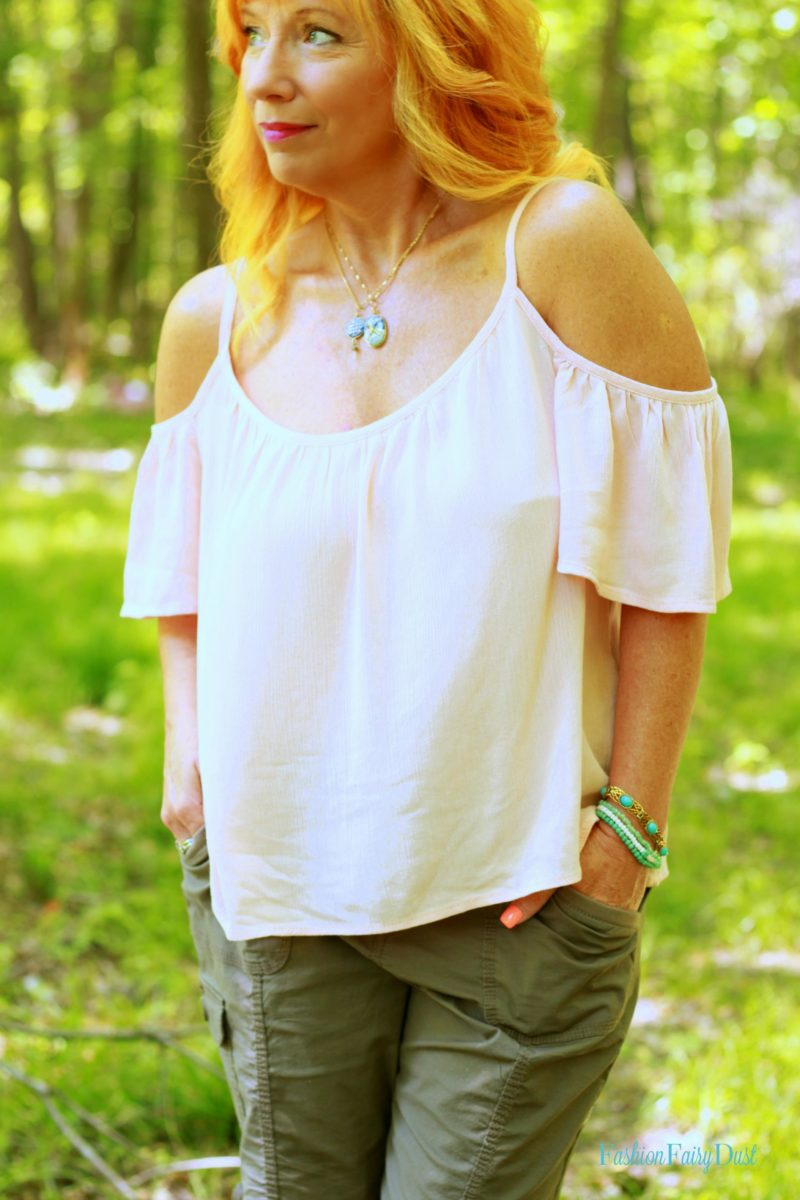pink off the shoulder top, cargo shorts, turquoise sandals