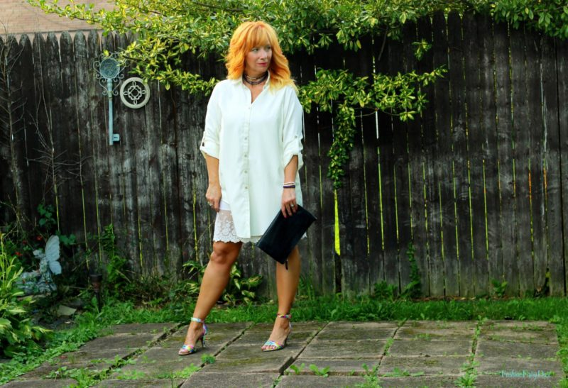 cream tunic, floral sandals, black clutch