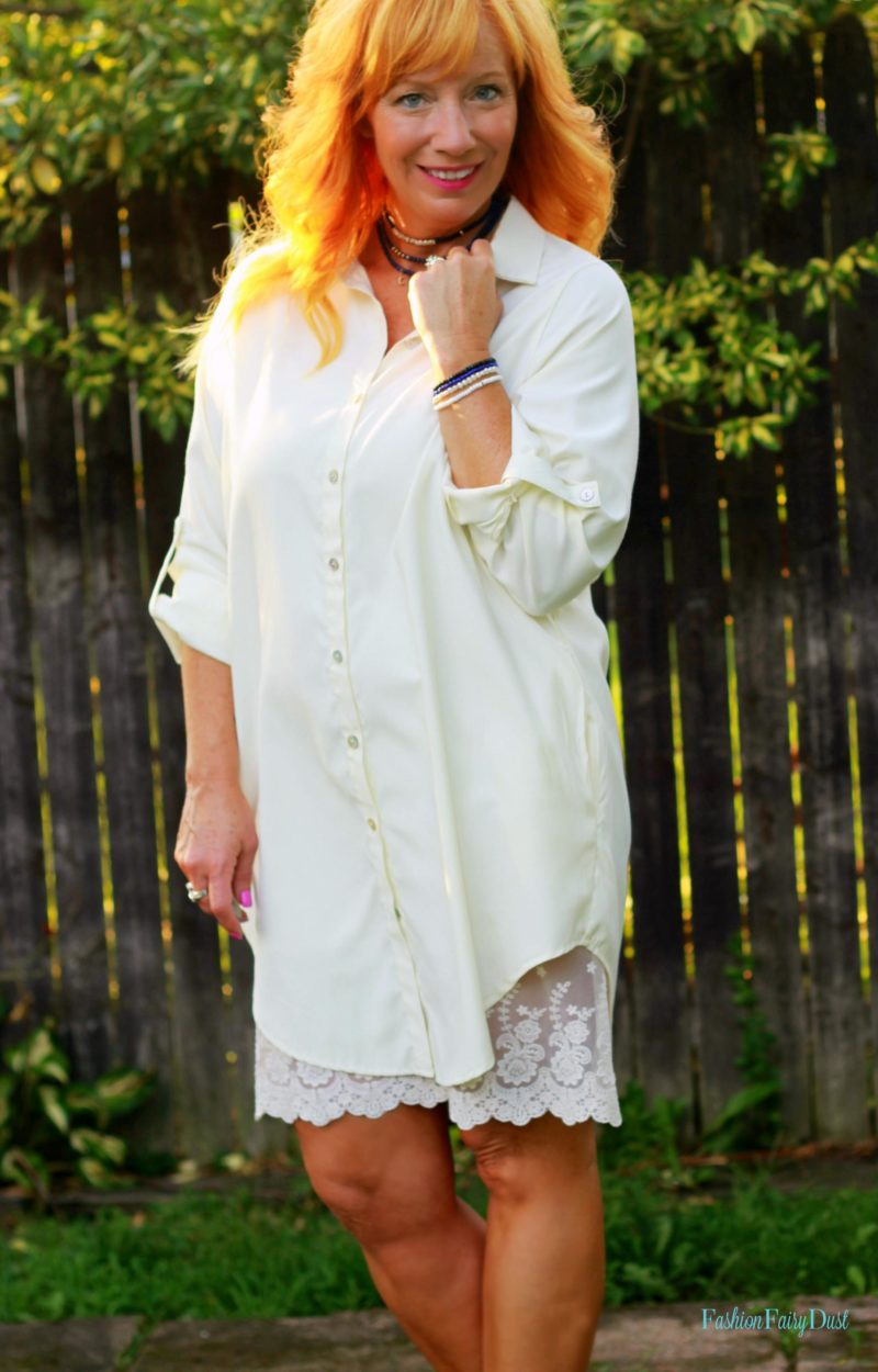 cream button up tunic, floral sandals, black clutch