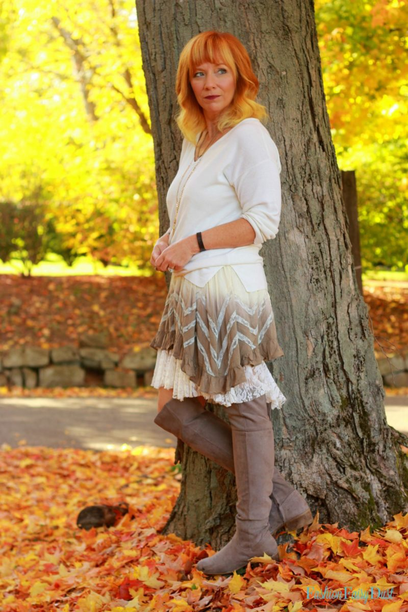 Boho tunic, over the knee boots and knotted sweater. Fall outfit inspiration.