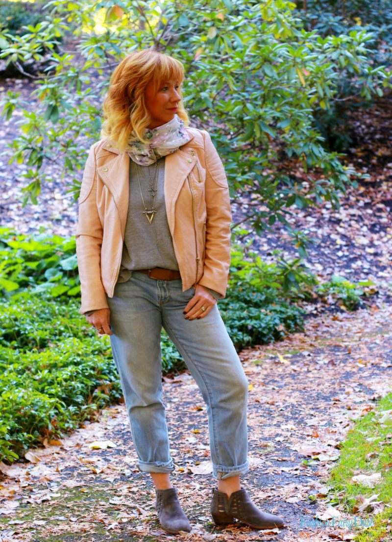 Pink moto jacket, gray ankle boots and boyfriend jeans. Dressing comfortably while still looking stylish.