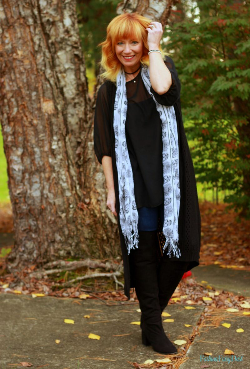 Blue drape front coat, black over the knee boots and skinny jeans. How to mix navy blue and black.