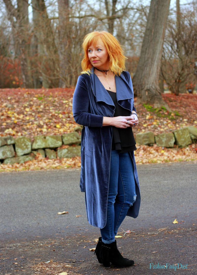 Blue velvet duster, distressed skinny jeans and ankle boots. How to style a casual holiday look.