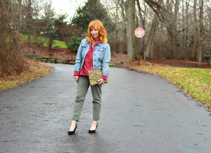 Red hooded sweatshirt, khakis and black pumps. How to style a sweatshirt for everyday wear.