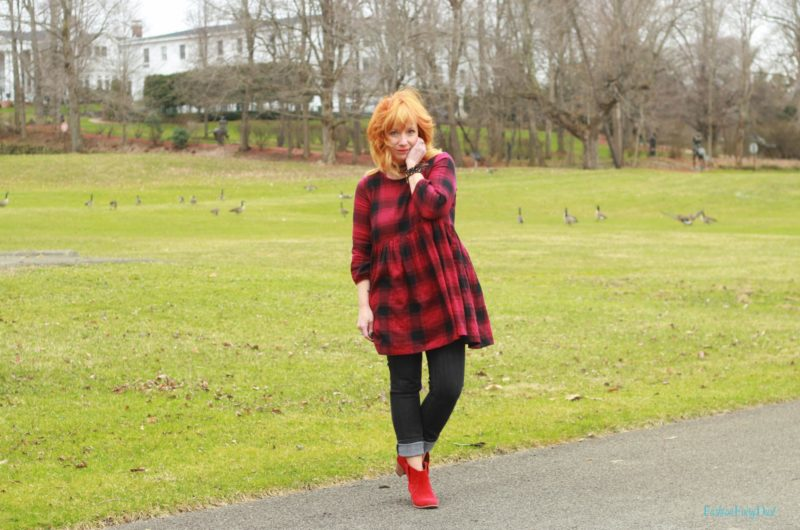 Buffalo plaid tunic, black skinny jeans and red ankle boots. Casual style.