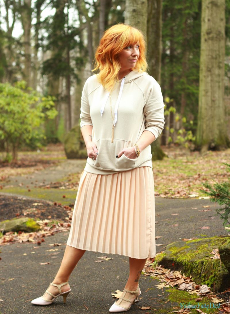 Embroidered clutch, blush pleated skirt and hoodie. How to pair casual with dressy pieces.