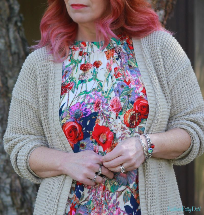 Floral tunic dress, chunky knit cardigan and over the knee boots. Dressing for Spring weather.