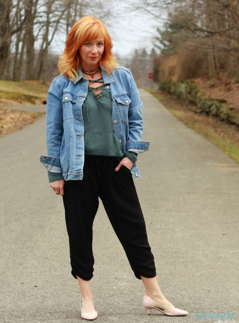 Teal lace up hoodie, black slouchy pants and denim jacket. How to do dressy casual.