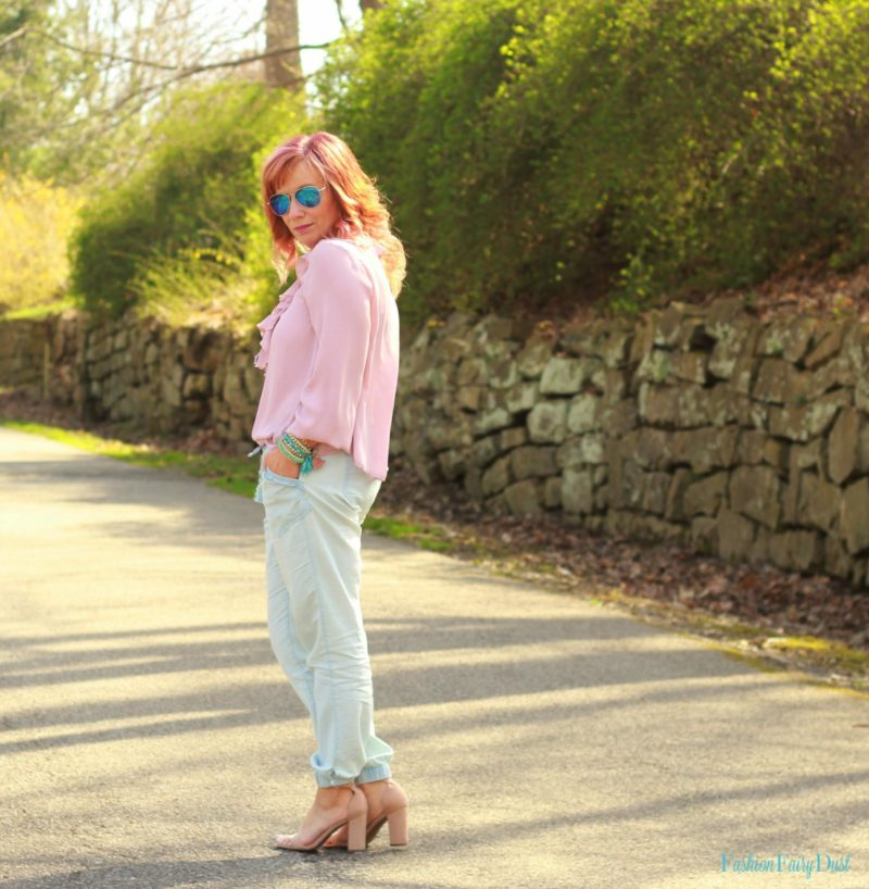 Pink ruffled top, chambray pants and nude block heel sandals.