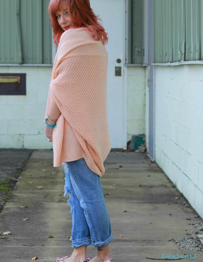 Peach cocoon cardigan, floral print flats and distressed jeans. How to toughen up pastels.