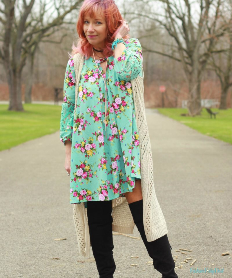 Turquoise floral tunic, long vest and over the knee boots. Styling a warm weather dress for cooler weather.