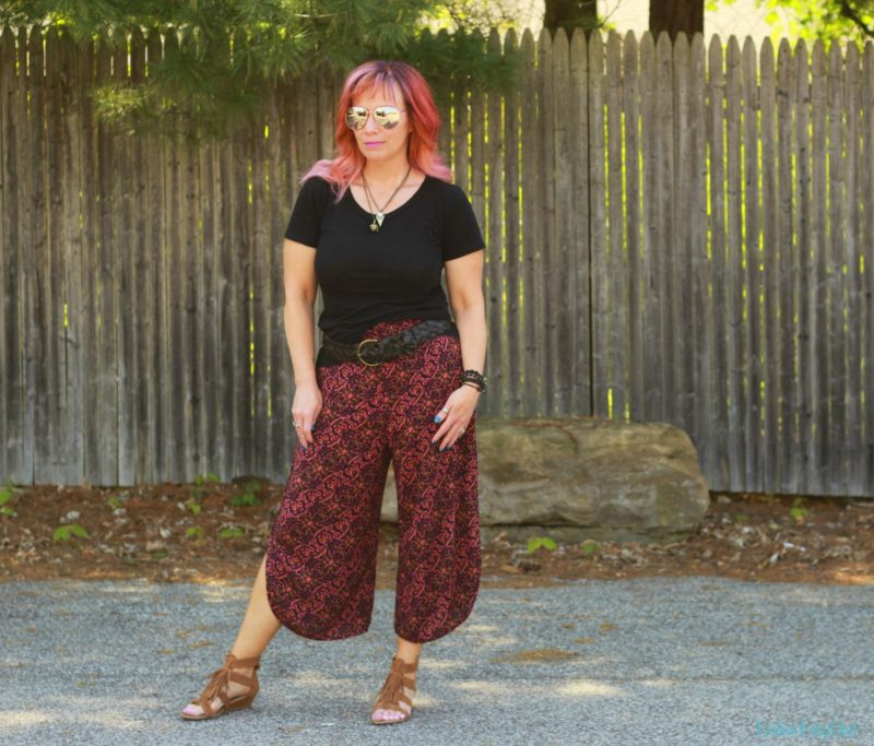 Print culottes, fringe sandals and black tee shirt.
