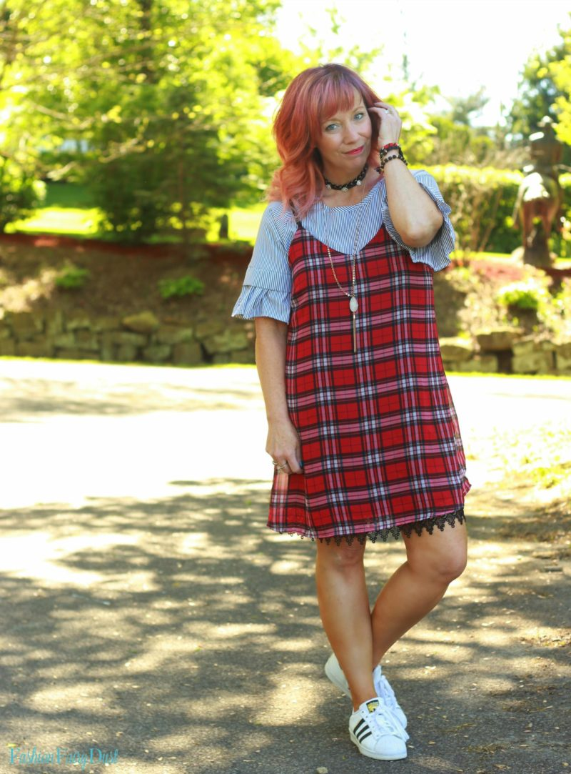 Plaid slip dress, striped top and Adidas.