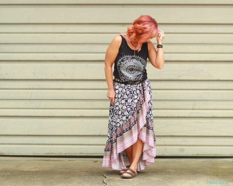 Ruffled skirt, moon graphic tank and sandals.