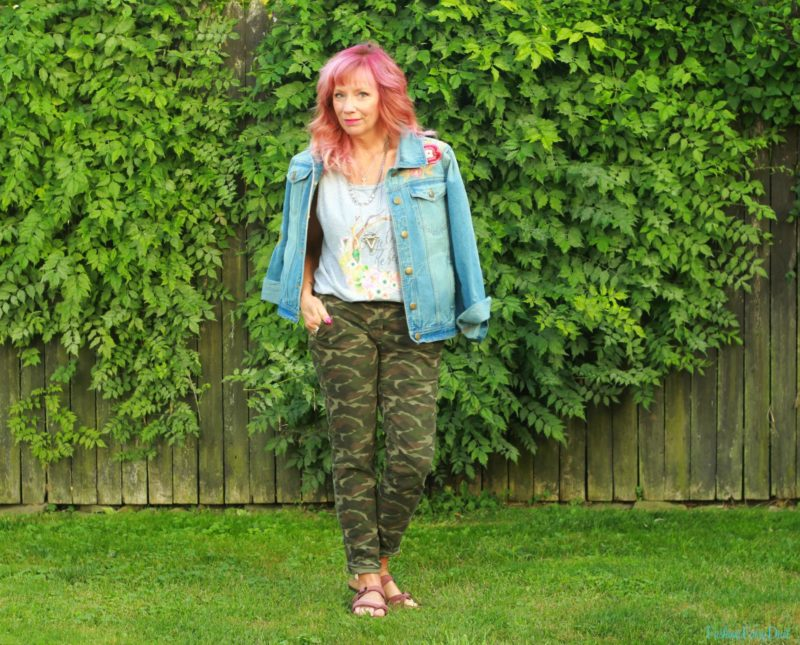Camo pants, embroidered denim jacket and graphic tank top.