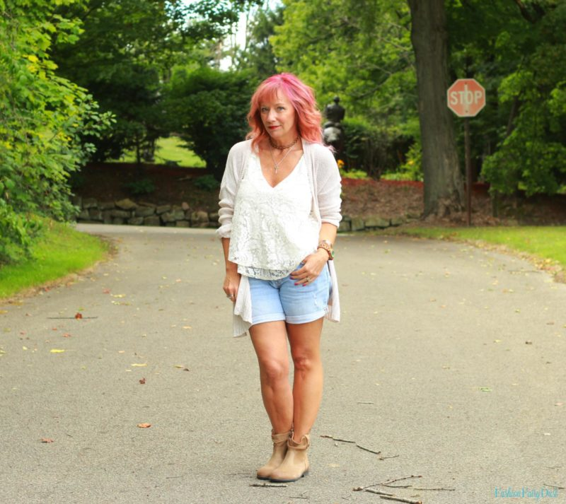 Lace tank top, Birkenstock boots, denim shorts and loose knit cardigan.
