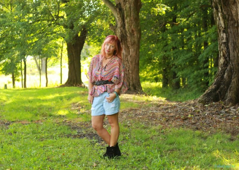 Kimono as a top, black ankle boots and denim shorts.