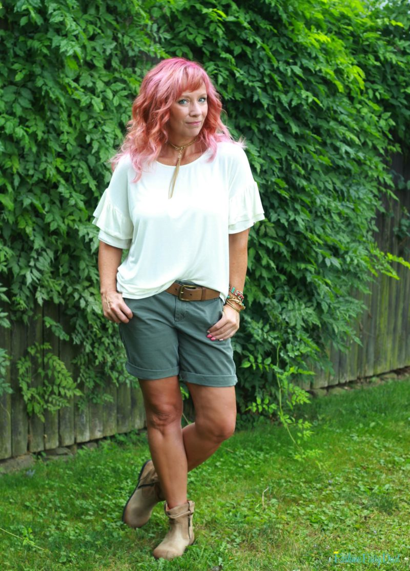 Ruffle sleeve tee, Birkenstock boots and khaki shorts.