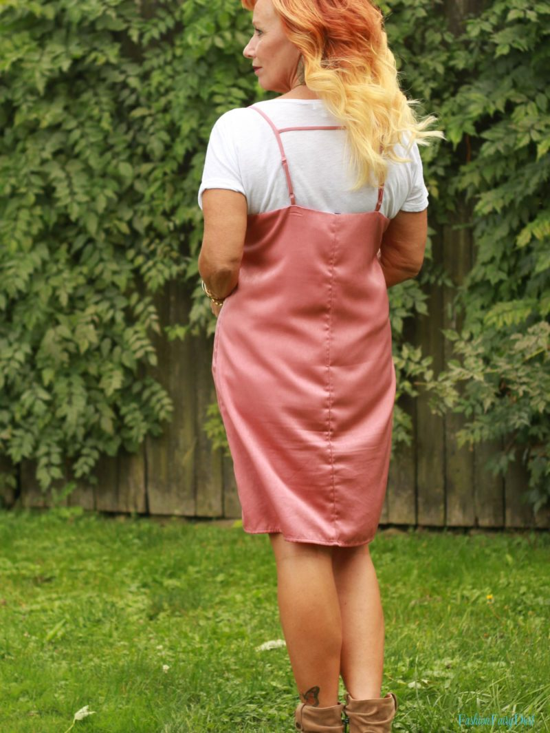 Pink slip dress, embroidered denim jacket and tan ankle boots.