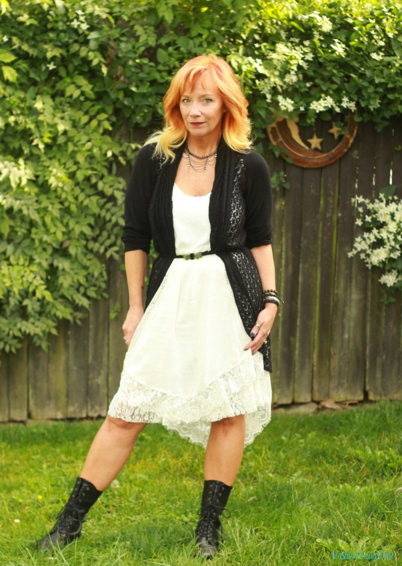 White slip dress, combat boots and black cardigan.
