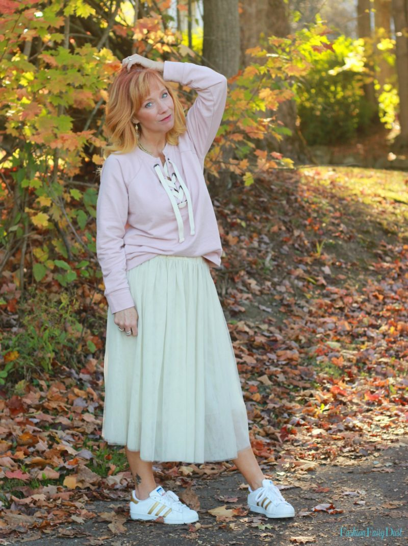 Pink lace up sweatshirt, tulle skirt and Adidas.