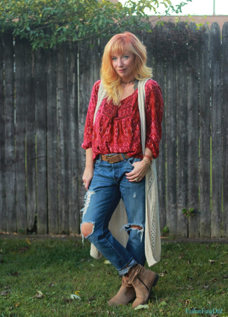 Boho top, boyfriend jeans, Birkenstock boots and fringe clutch.