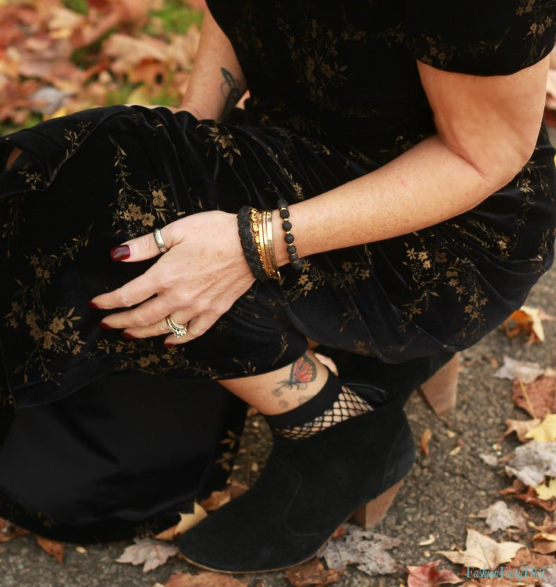 Black velvet maxi dress and black suede ankle boots.