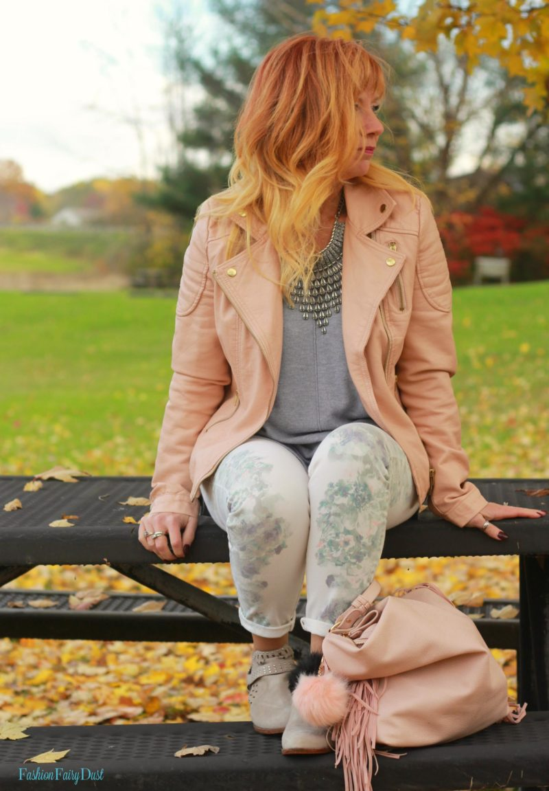 Floral print jeans, pink moto jacket & gray sweater.