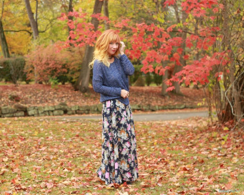 Floral print maxi dress, blue sweater, blue suede boots.