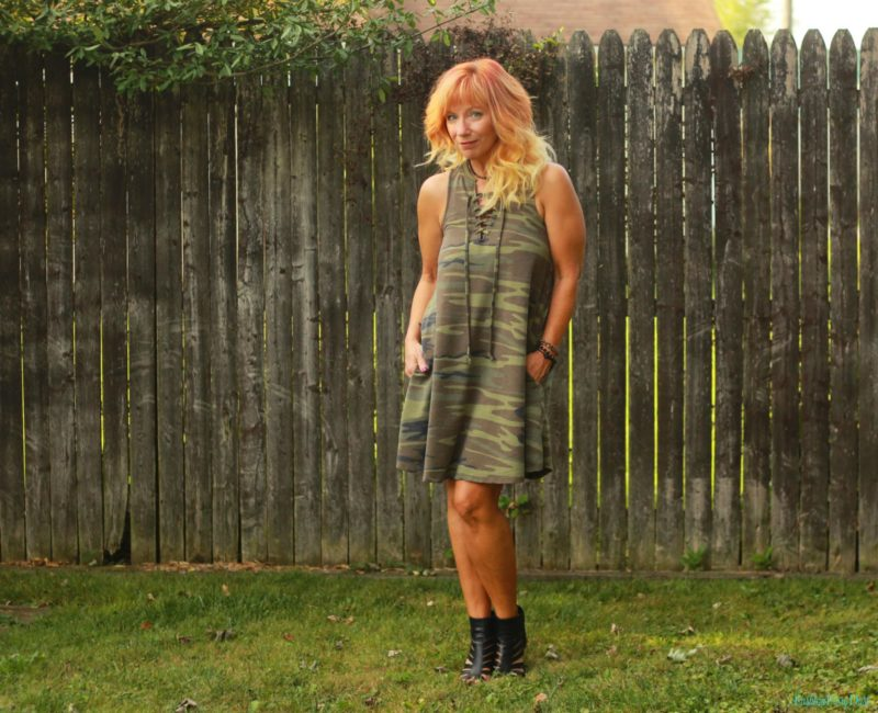 Camo dress, cage booties and denim vest.