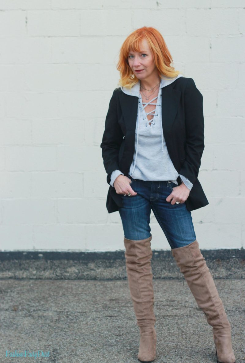 Black blazer, hoodie and over the knee boots.