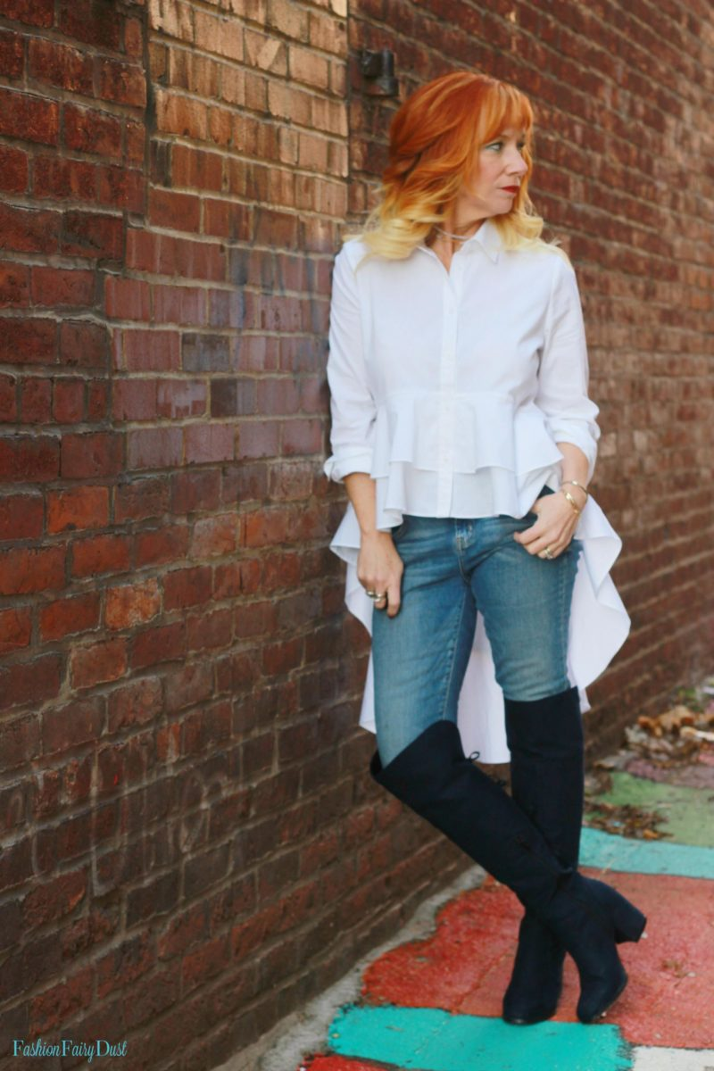 Ruffled high low hem shirt, over the knee boots and skinny jeans.